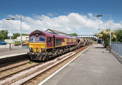 180614  66164 has run around its train and prepares to propel it back under the bridge in the distance before drawing it into St Blazey yard.Last time I did this shot it was off double headed 67's on the TPO stock.