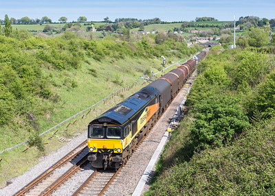 030514   66849 passes Chiiping Sodbury with an early running 6V62 11:00 Tilbury-Llanwern.How come when a grid is on this working it all goes down the pan but when a shed is on it you always bag it in the sun.Still shed or not I do like the Colas livery so well pleased with this and a happy drive home.