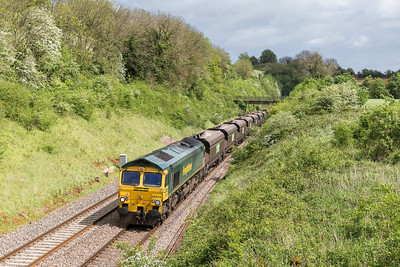 """090514  In our new """"try harder"""" regime another trip to Bristol with a good forecast.Driving up the mortorway near Bristol it was 8/8 ths cloud everywhere!!! Not what I really wanted but it came in a lucky patch of sun......66563 on 4V09  07:29 Rugeley-Stoke Gifford passes Wickwar."""