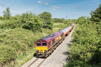 030514  After running around at Yate (Tytherington) 66142 leads 6B13 05:04 Robeston-Westerleigh down the branch at Westerleigh village.Normally would be disgusted with a shed but it is unusual to see them on this working (thank goodness)