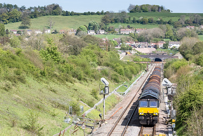 030514  66849 passes Chipping Sodbury with an early running 6V62 11:00 Tilbury-Llanwern.The assistant mans the tripod to get a shot that will definitely not be on soon.