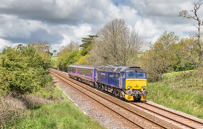 """130514    I panicked and drove about a mile down the line and it looked like we had no chance until a nice break in the clouds came......57602 passes bethany with 5Z11 1020 Penzance to Plymouth """"trainer""""."""