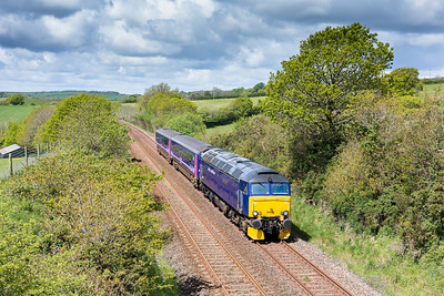 """130514   Despite the forecast there was a tremendous amount of cloud around,in case we got lucky I left the assistant here to man the tripod and she bags a cracker..... 57602 passes Bethany with 5Z11 1020 Penzance to Plymouth """"trainer""""."""