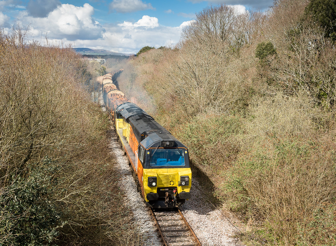 250315   70804 is about to pass Jetty Marsh bridge on the way down from teigngrace to Newton Abbot.Forming the 6M51 Teigngrace to Chirk.
