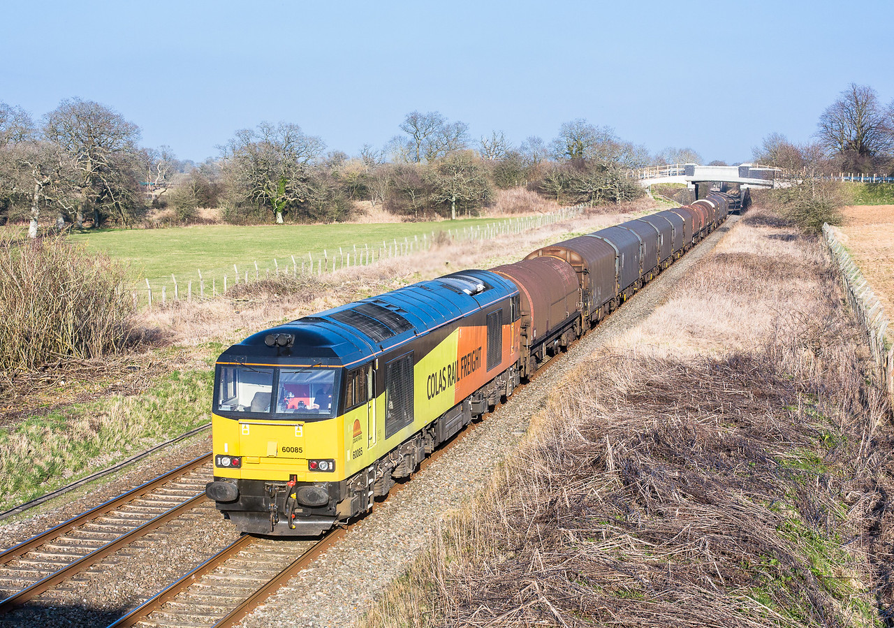 210315  The sun angle had gone at my bridge but the assistant bags 60085 on the  the 6V62 10:56 Tilbury-Llanwern past Acton Turville. Three freights in just over an hour.