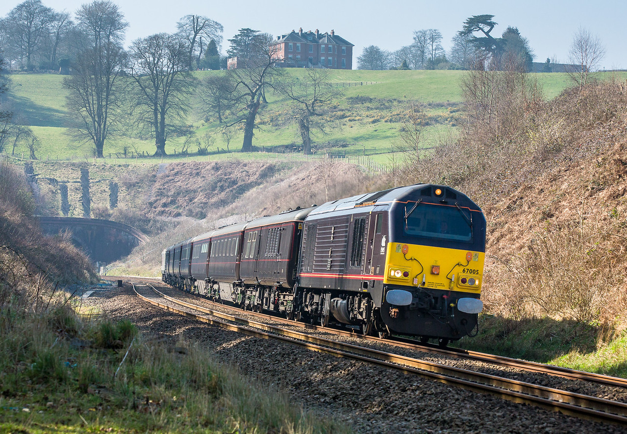 """200315   The assistant mans the tripod and bags """"ones train""""....With the eastern portal of Whiteball tunnel visible 67005 TnT 67026  pass Marlands with the with ECS 1110 Plymouth to Wolverton."""