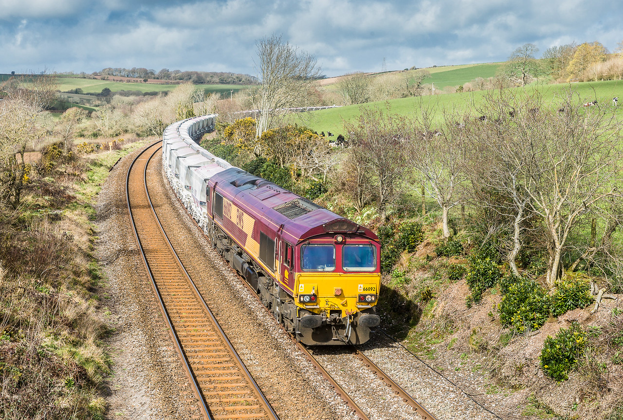 260315  After seeing this in a John Vaughan book decades ago. I have always wanted this shot,but have been beaten back by brambles/hawthorns. 66092 has just exited Treverrin tunnel and heads the 6G07 13:20 Fowey-Goonbarrow.Really pleased with this as once the clocks go forward the light angle is not so good,so this was the final day to get it!.....Mega