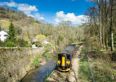 160416  153305 heads over the bridge to Tregarland with a service to Looe