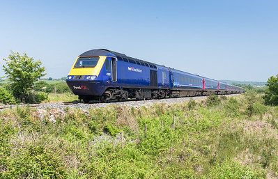 050616   43197/43156 have just crossed Menadue crossing near Goonbarrow and head the 1C77 1000 London Paddington to Newquay