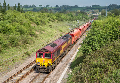130516, After standing in full sun for 3 hours the clouds  started to steam in when the two freights were due...... 66043 passes Chipping Sodbury with  6Z47 1303 Acton T.C. to Cardiff Docks Ryans F.W.