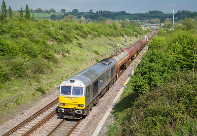 130516    The bridge parapet has been raised here but the shot is still well on.......60066 heads through Chipping Sodbury with 6B33   13:00 Theale-Robeston
