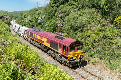 310516   Having picked up its remaining 16 CDA's 66027 heads past Foxhole and towards Burngullow,then onwards to  Fowey.