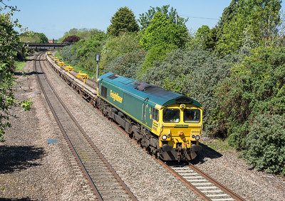 150516  A bit of a Sunday freight fest at Taunton,with several engineers coming to run round at Fairwater.First up...... 66550 passes Creech St Michael with the 6Y70 0858 Castle Cary-Westbury...the assistant mans the tripod.