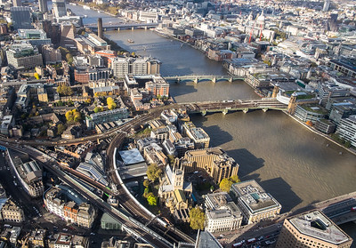 A EMU rounds the curve into London bridge statrion and is about to pass Southwark Cathedral