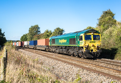 051016  The assistant is abandoned with the tripod 9again)....66512 thunders throught the old Tetbury road goods yard site with the 4O57  13:29 Wentloog(Cardiff)-Southampton,diverted this way due to the severn tunnel closure.