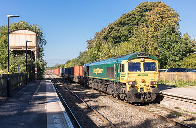 66512 passes the old water tower (built 1872) at Kemble station with the diverted 4O57  13:29 Wentloog(Cardiff)-Southampton