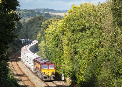171016  The assistant is left on the farm bridge and bags the telephoto shot.... 66023 heads up Trevarran bank near Milltown with the 6G07  13:20 Fowey-Goonbarrow