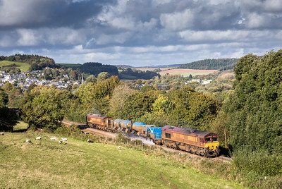 171016   get them whilst they are clean...to late for that but still quite a view..... 66160 Tnt 66238 heads up Treverran bank with the 3J13       08:45 Westbury-St.Blazey