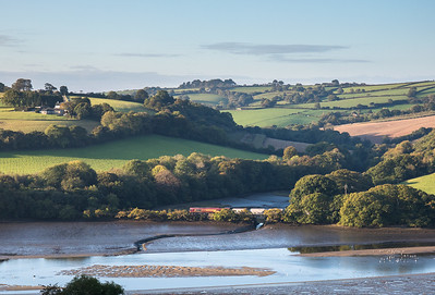 031016 .  66023 crosses the inlet at woodgate Pill and heads towards Fowey with the 6G06  07:39 Goonbarrow-Fowey