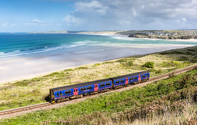 250916 With Godrevy and the Towans providing the backdrop 150246 passes Porth Kidney sands with the 2A27 1418 St Erth to St Ives