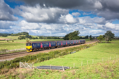 170916...150925 heads the 2T12 1025 Exeter St Davids to Paignton past the big sky at Powderham