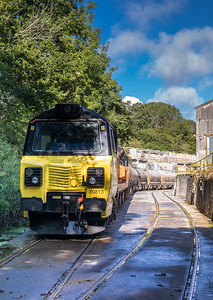 310817  70813 waits at Moorswater works before departing with the   6C36  ThO  11:38 Moorswater-Aberthaw cement works