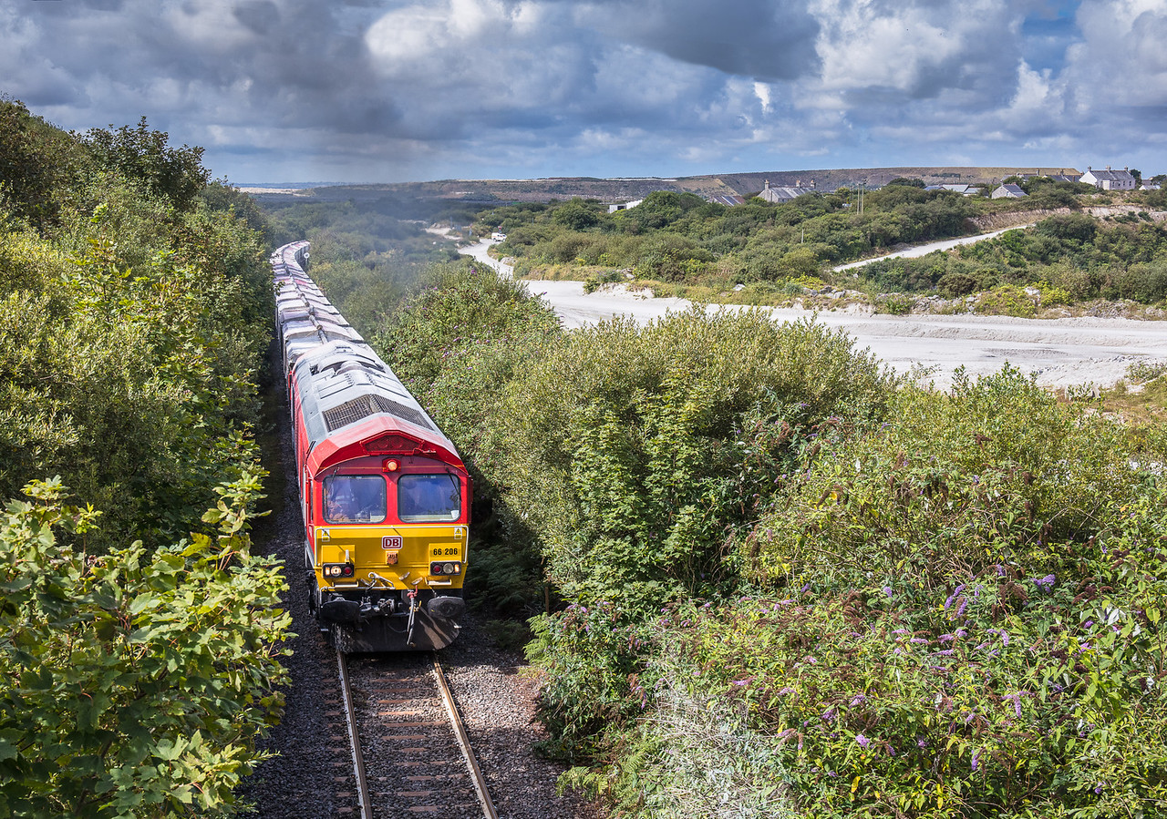 150817  66206 heads down the branch near Rostowrack downs with the 6P24 15:25 Parkandillack-Fowey.Treviscoe is in the background as is the Virginia china clay works.