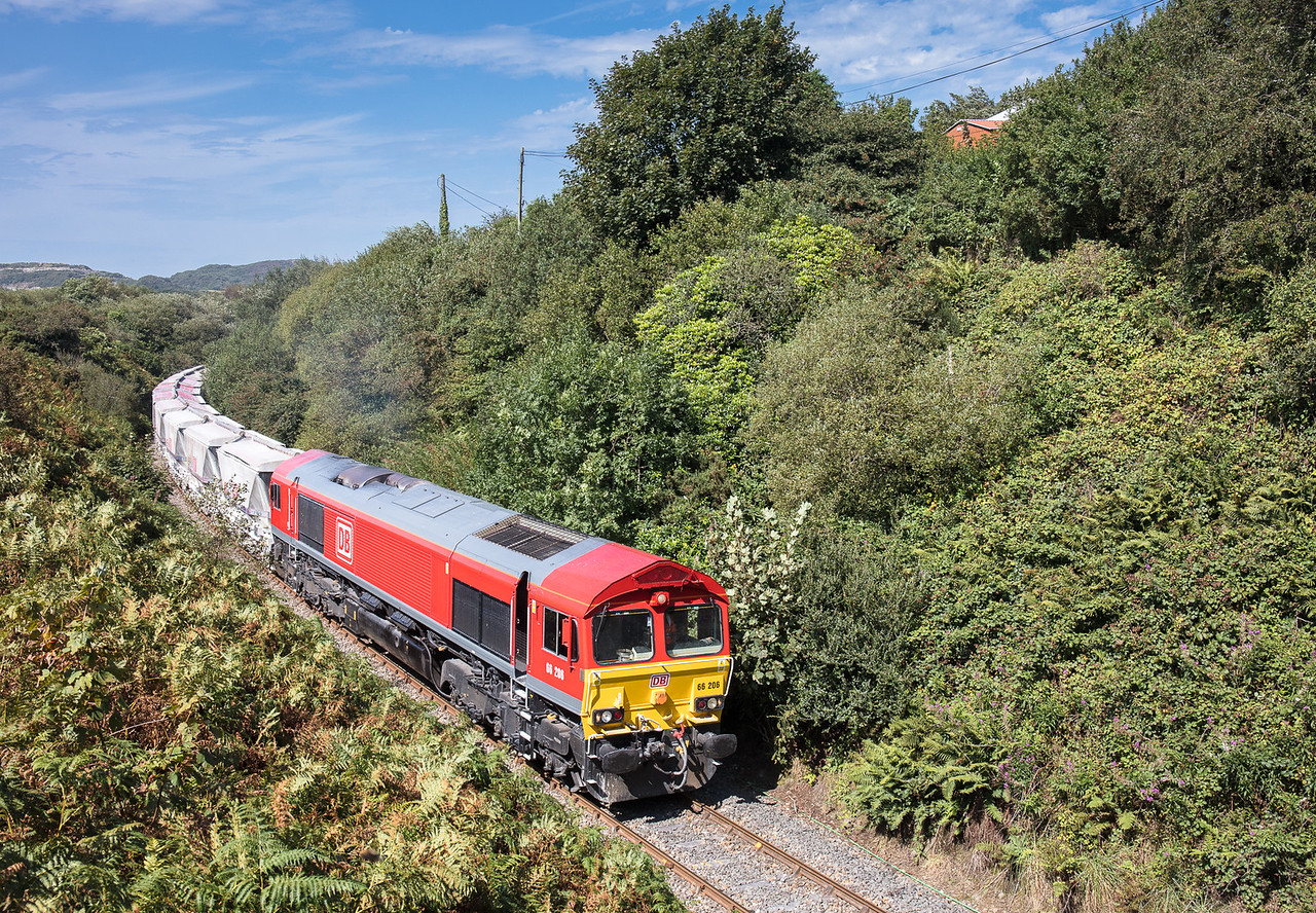 220817  1446....With 13 CDA's in tow,66206 rounds the curve at Foxhole and heads towards  Burngullow,where it will pick up the 25 CDA's already there and form a fully loaded 38 CDA train departing as the   6P24 15:25 Parkandillack-Fowey