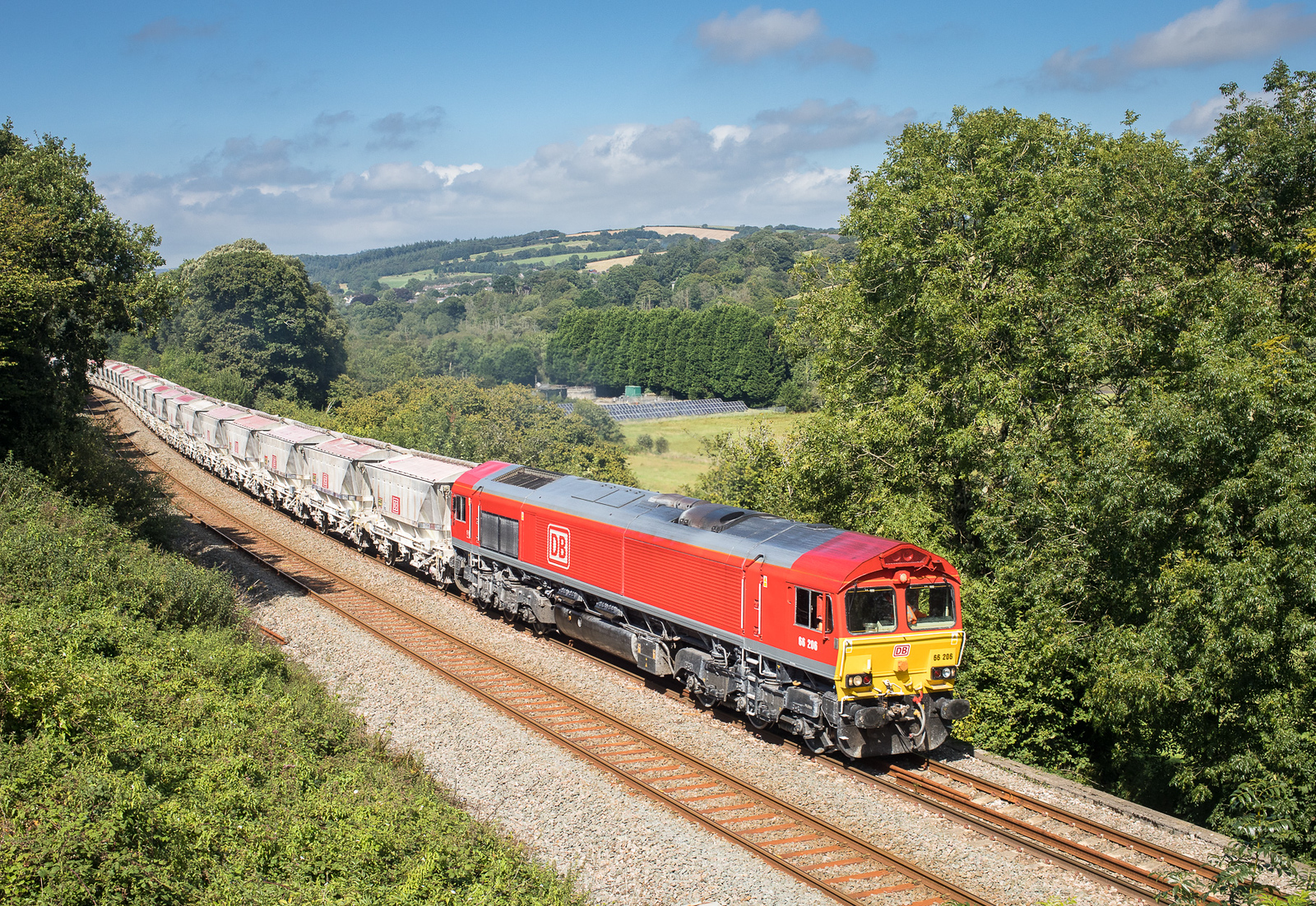 210817  66206 approaches the farm bridge at Milltown with the 6G07 13:50 Fowey-Goonbarrow