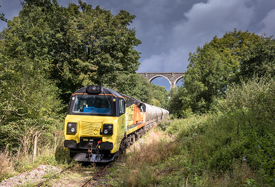 310817   70813 waits for its path up the branch and bides its  time at Lamellion overbridge.