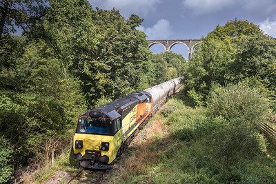 310817  70813 on 6C36  ThO  11:38 Moorswater-Aberthaw cement works draws to a halt under lamellion overbridge where it will wait until the unit departs Coombe junction.
