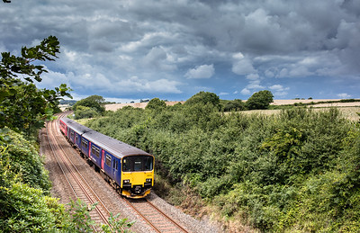 010817  . 150124 heads the 2P86 1141 Penzance to Newton Abbot under threating skies at Crift lane