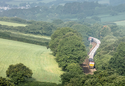 130717 .66020 heads the 6G06   07:39 Goonbarrow-Fowey out of Par and up grade towards Trevarran tunnel.