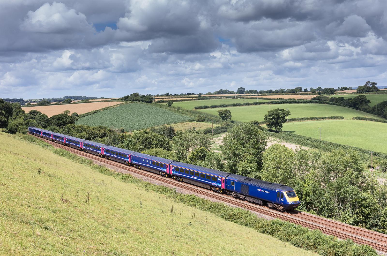 200717  43125 heads the 1A85 1047 Penzance to London Paddington downgrade near Treboul.