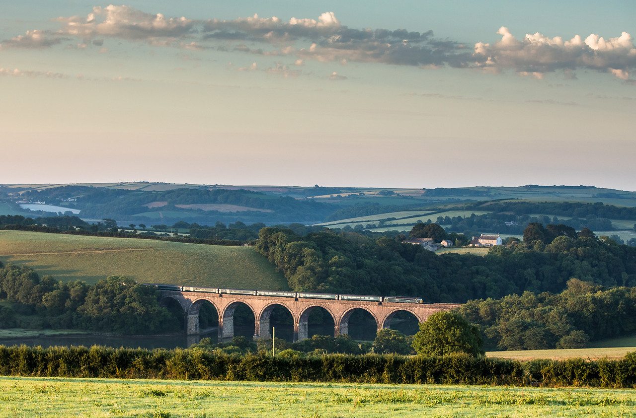 060717 57605  With Grove farmhouse inas abackdrop,57602 heads over Lynher viaduct with the 1C99  23:45 Paddington-Penzance