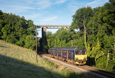 060717 150121 heads the first service train of the day from Looe the 2L72 0637 Looe to Liskeard under Liskeard viaduct .