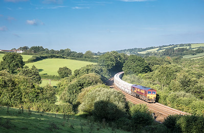 240717  66025 is moving very slowy as it takes its load of 38 CDA's away from Par up Treverrin bank  near treesmill.