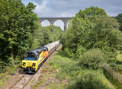 010617  70815 has just left the works with 6C36  ThO  11:38 Moorswater-Aberthaw cement works and is about to stop at Lamellion overbridge to await a unit to clear Coombe junction.
