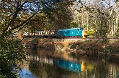 05117  Class 37 6975 heads doewn the banks of the River dart with the 1222 Buckfastleigh to Totnes