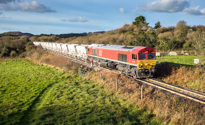 081117  66206 heads the second portion of  CDA wagons over Carpalla crossing,after forming the complete train at Burngullow it will then head off as the 6P24 15:25 Parkandillack-Fowey