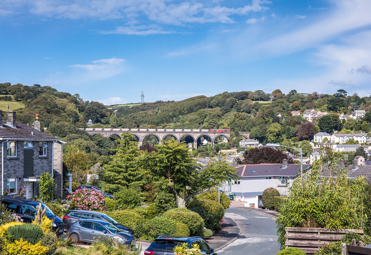 010917  After combining the two loads at Burngullow ,66206 ,complete with 38 CDA's heads over St Austell viaduct with the  6P24  15:25 Parkandillack-Fowey