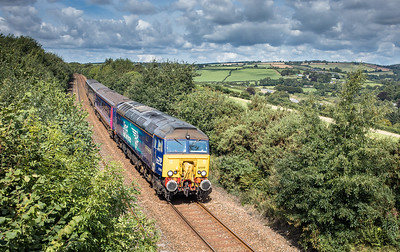 020917  Hired in DRS 57310 heads the 2P70 1028 St Erth to Plymouth onto Moorswater viaduct and into Liskeard