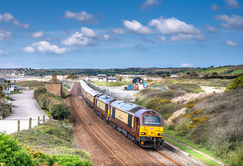 290418 67024/67021 pass Marazion with the  ECS working, 1035 Penzance Slopers Sdg to Truro.