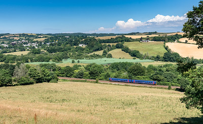 120718  .158763 leaves Lostwithiel behind it and heads upgrade to Par with the 2C47 1409 Plymouth to Penzance