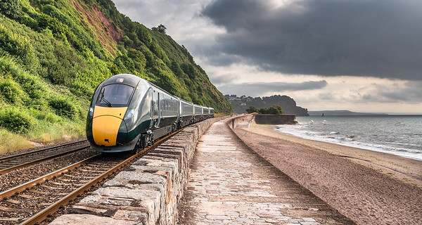 100718  .800029 approaches Teignmouth with the 5Z80 0605 Stoke Gifford to Plymouth