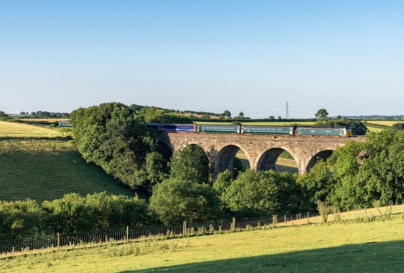 "090718  57602 ""Restormel castle"" heads over Bolitho viaduct and on into its booked stop at Liskeard with the  1C99 2355 London Paddington to Penzance"