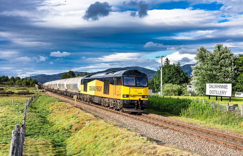 220618  60096 passes the distillery at Dalwhinnie with the 6B31 WFO 17:59 Inverness-Oxwellmains