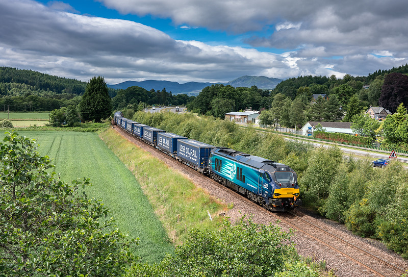 220618.   68033 heads the 4D47  13:07 Inverness-Mossend  around the curve at Ballinluig