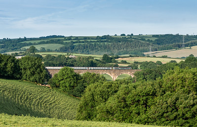 040618   57602 heads over Bolitho viaduct and slows down for its stop at likeard with the down beds.