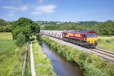 060618  ..66031 is caught between Ponts Mill and St Blazey as it heads the 6G08  16:29 Goonbarrow-Fowey